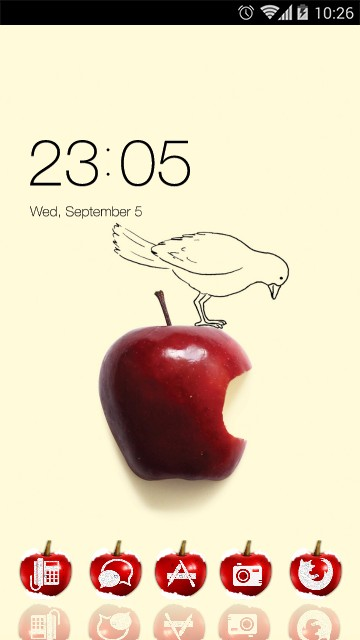 bird on red apple